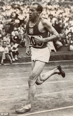 Zatopek in a pair of minimalist shoes