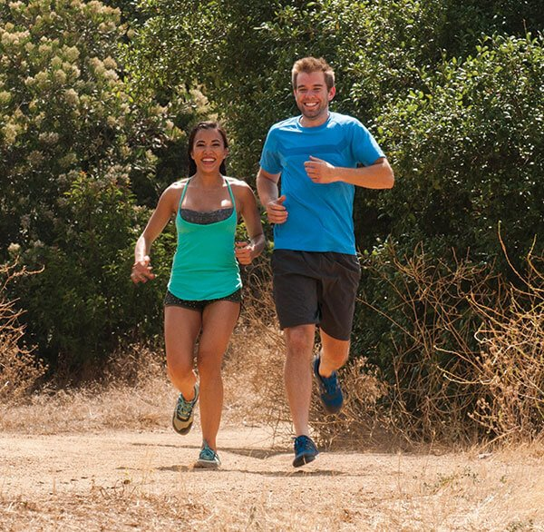 Couple Running wearing Xero Prios